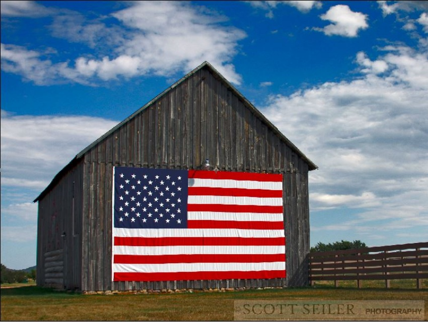 Rustic Barn With American Flag